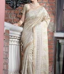 Buy Beige tussar silk thread worked saree in shimmering golden border- tussar-silk-saree online