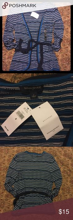 NWT Banana Republic Belted Cardigan NWT Banana Republic Belted Cardigan. Size small. Teal and black stripes. Beautiful, comfortable, and stylish. Bundle and save! I accept reasonable offers. From a smoke free 💨🚫, pet friendly 🐶 🐱 🐦 home 🏡. Banana Republic Sweaters Cardigans