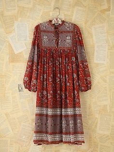 Vintage floral printed gauzy cotton Indian dress with quilted bib neckline with ties. Billowy peasant sleeves. 100% cotton. $328.00 by Free People