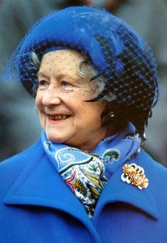 Queen Elizabeth, The Queen Mother at Cheltenham races wearing her gold & diamond three flowers brooch.