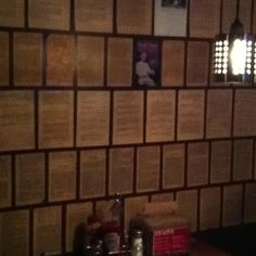 Decoupaged wall with book pages at Twain's Billiards in Decatur, GA