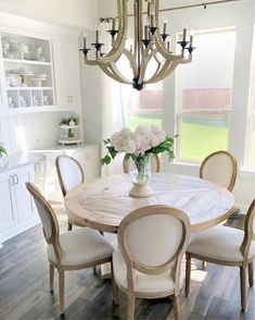 modern farmhouse dining room design, neutral dining room, modern dining room table with dining room chairs and chandelier with white walls and neutral rug Home Interior, Interior Design, Interior Livingroom, Interior Plants, Interior Decorating, Decorating Ideas, Circle Table, Dining Room Design, Round Dinning Room Table