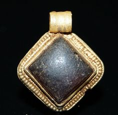 A beautiful 7th Century Anglo-Saxon gold and cabachon garnet filigree pendant