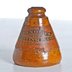 "Ink:  A seldom-seen 1840 - 1850 stoneware bottle of  P Arnold's ""Chemical Writing Fluid"" (#ink), with not only the original paper label, but also the original unopened wax seal impressed with the P Arnold firm name."