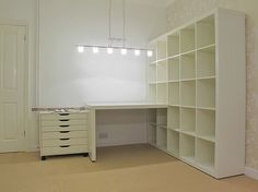 Ikea Expedit 5x5 with desk attachment by guadalupe