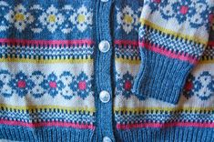 A lovely vintage 1960s wool knit cardigan sweater in the Norwegian tradition.
