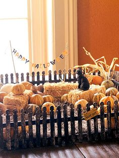 "Fenced-In Fall Centerpiece  Let a trip to a crafts store inspire ideas for a versatile centerpiece to carry you through the season. Use miniature fencing or a shallow basket to frame a ""yard"" of Spanish moss, small hay bales, and gourds. A black cat and ghoulish signs stake the territory at Halloween; turkeys can gobble up space later."