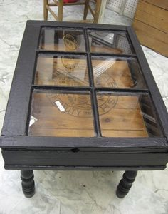 DIY Coffee Tables: Make a coffee table out of a salvaged window.i would love to do this with cacti inside