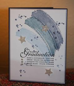 handmade card: Graduation in Blue and Silver by CAKath  ... Work of Art swooshes in blue ... scattered sparkles ... stars punched from glitter paper ... silver brads ... blue jewels  ... Stickles dots ...luv it! ... Stampin'Up!