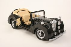 https://flic.kr/p/axdjmv | Alvis TA 28 | This is a fictitious model, inspired by the Alvis cars produced after the World War II. It is also my first MOC after I became a LEGO Designer. I'm not a particular fan of cars - as you may noticed they have never been the protagonists of my creations - but this time I felt like challenging myself. I really enjoyed building it, mostly the 2 last days that I spent finishing 70% of it (the first 30% were just laying around for months, under a thick…