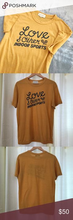 """NWOT Rachel Antonoff Tee Super soft cotton/poly/rayon blend tee feature front print """"love & other indoor sports"""" and heather gold color. NWOT and perfect condition! Rachel Antonoff Tops Tees - Short Sleeve"""