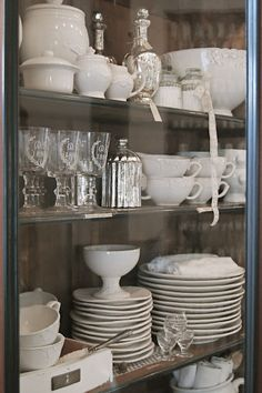 Love how these dishes are arranged ans the simple elegant colors-- white, silver, gray.  Lovely