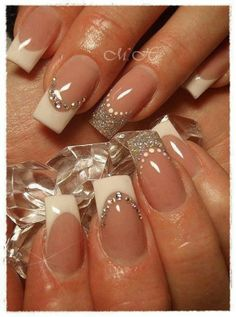How glam are these square cut nails? A little bit of a different design on each nail keeps it interesting. Love all the sparkles!