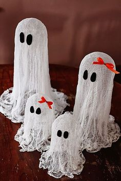 Halloween Decorations. These floating ghosts are so darn cute and very easy to make, cheap also.