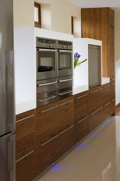 Walnut. Floor to Ceiling cabinet at the end