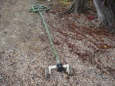 A method to get the water pump intake out to deep water and off the bottom.  Made of lawn mower wheels and some old clothes rack materials