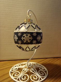 Snowflakes at Midnight Beaded Glass Ball Ornament. $150.00, via Etsy.
