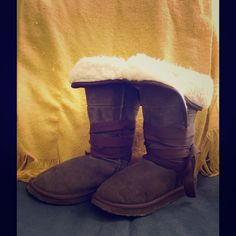 "Emu suede shearling ribbon tie boots size 8! Great pair of pre-loved leather Emu boots women's size 8! These boots feature chocolate brown suede exterior, nice warm shearling interior, and stylish, long ribbon that wraps around the boot several times then ties in a bow. SO cute!! These have a been worn a few times and are in good gently used condition and have plenty of life left in them! Bundle 2 or more items and save 20%!! OR make me a reasonable offer via the ""Offer"" button! Emu Shoes…"