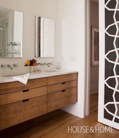 Handsome Double Vanity | Designer: Richard Ouellette & Maxime Vandal | Photographer: Jean Longpré |