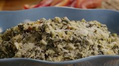 Hot Artichoke Spinach Dip | Your guests will love this versatile, cheesy warm dip.