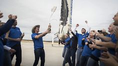 Blue Origin billionaire founder Jeff Bezos (Amazon.com's CEO) and team members celebrate after the successful first spaceflight and landing of its New Shepard spacecraft and booster. The test flight launched from West Texas on Nov. 23, 2015.<br />