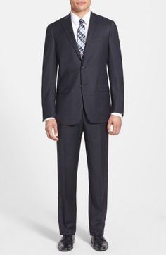 80f257035 Sharp worsted stretch-wool elevates a handsome, American-made suit  fashioned in a timeless, two-button cut and featuring flat-front trousers  for versatile ...