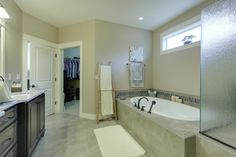 Walk in closet situated off the master bath. Designed and built by Quail Homes of Vancouver WA.