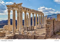 Temple of Trajan in Pergamon near Dikili, Turkey - This is the Roman monument in the ancient Greek city of Pergamon with awe-inspiring ruins. The monument was named after the Roman emperor Trajan (who started the construction, and it was finished by Hadrian, his successor). Pergamon is close to Dikili, Turkey, a small coastal town spread out around the shore of a broad bay in the Aegean, on the north coast of Turkey.