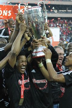 Orlando Pirates celebrate winning the Absa Premiership Final match against Golden Arrows at Orlando Stadium on May 2011 in Soweto, South Africa. Happy People, Arrows, Finals, Orlando, Pirates, Celebrities, Sports, Hs Sports, Orlando Florida