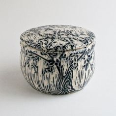Ceramic carved sgraffito box/ container with two trees in a rainy day