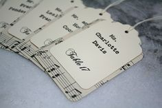 Wedding escort card, seating card.  Unique layered escort cards made from vintage sheet music pages.  Custom printed.. $1.00, via Etsy.