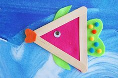 Using wood craft sticks, felt and some fun colorful embellishments, you too can pull this adorable DIY fish craft together with your child in no time!