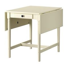 "IKEA - Drop Leaf Table with storage drawer - $129.00 Length: 34 5/8 "" Min. length: 23 1/4 "" Max. length: 46 1/8 "" Width: 30 3/4 "" Height: 29 1/8 """