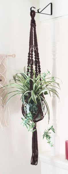 If you love vintage with a more modern look, here is a beautiful macrame plant holder that will look great in your home! BROWN Macrame Plant Hanger, Vintage Style Macrame Hanging Planter, Modern Plant Holder, Beaded Pot Hanger, Large Pot Holder Hippie 70s Decor