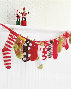 This hanging Advent calendar assembled from a mix of stray or new baby socks and a ribbon is full of great things, and it's the perfect way to mark the season for a baby or an older child. Stuff each mini stocking with an age-appropriate toy.
