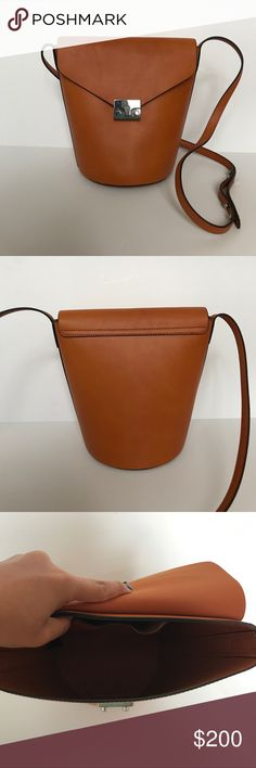 """Loeffler Randall brown leather handbag Brand new Loeffler Randall purse. Comes with dust bag and care card. Approximately 9"""" tall, 9""""wide, and 6"""" deep with 19"""" strap. Loeffler Randall Bags Crossbody Bags"""