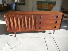 Sculptural Walnut Credenza Designed by Albert Parvin, circa 1950s | From a unique collection of antique and modern credenzas at https://www.1stdibs.com/furniture/storage-case-pieces/credenzas/