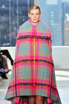 We're absolutely in love with the watercolor-like quality on this oversize plaid cloak at @DELPOZOofficial #nyfw #aw14