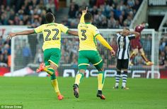 Jacob Murphy (left) celebrates with Martin Olsson after extending Norwich's lead to 3-1
