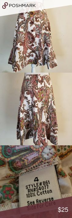"""CAbi  paisley print A-line pleated skirt size 4 Multi color floral paisley print 4 center front pleated skirt is in great condition. Skirt does not have a slip underneath,thick enough to not be see thru. Back side does have a zipper to secure the waist  Waist is 14"""" While length of skirt is 25"""" No flaws Style number 861 CAbi Skirts A-Line or Full"""