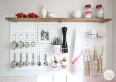 Emulate Julia Child and set up a pegboard organizer that keeps all your kitchen tools within an easy reach. | 34 Ways To Make Your Kitchen The Best Part Of Your Home