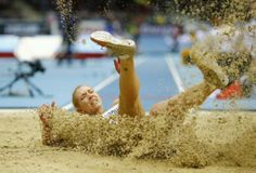 Ukraine's Alina Fodorova competes in the long jump event during the women's pentathlon at the world indoor athletics championships at the ERGO Arena in Sopot March 7, 2014. REUTERS/Kai Pfaffenbach ...