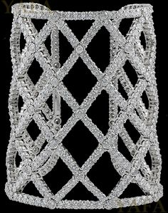 BOUCHERON Diamond Dalila Cuff Bracelet.18k white gold diamond cuff, of broad openwork chequerboard design, set throughout with circular-cut diamonds, inner circumference 17.0 cm, signed Boucheron. Circa 1980