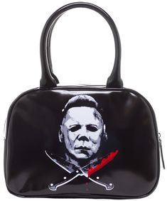 ROCK REBEL MICHAEL MYERS CROSSED KNIVES HANDBAG - This glossy vinyl purse by Rock Rebel features Mike Myers' latex face above two crossed knives of course dripping with blood. Lock up your children, lock your doors, hide as best as you can! There is really no escaping this psycho killer! This handbag features an inner zip pocket and cell phone holder, full zip closure, metal feet and rolled handles and is completed with black satin-like liner.