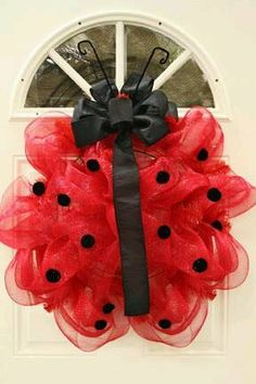 Super fluffy adorable outdoor Ladybug wreath made of toole. Found on facebook with no credit to the photographer. If you hold the copyright to this image, please contact me for proper credit!