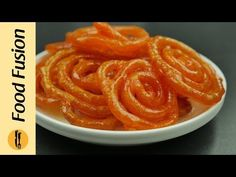 Recipes Jalebi : Instant Jalebi Recipe by Food Fusion - Recipes Jalebi Video Recipes Jalebi The simplest and the fastest way to make crispy Jalebi. Try this instant Jalebi recipe and enjoy. Recipes in Urdu and Indian Desserts, Indian Sweets, Fun Desserts, Indian Food Recipes, My Recipes, Cooking Recipes, Amazing Recipes, Recipies, Jelly Bread