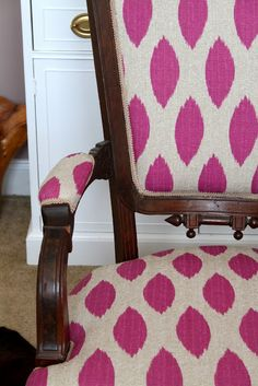 Easy upholstery. Just remove trim, staple new fabric over old and glue new trim on.