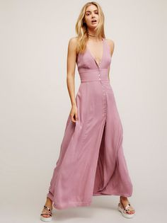 All About It Maxi | Crinkly maxi dress with a V-neckline, button closures down the front and a slit on the skirt. Racerback with embroidery detailing around the waist.