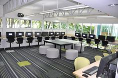 Nice library/computer lab setup! Thinking about busting up the walls to have just as much window light as this classroom!!