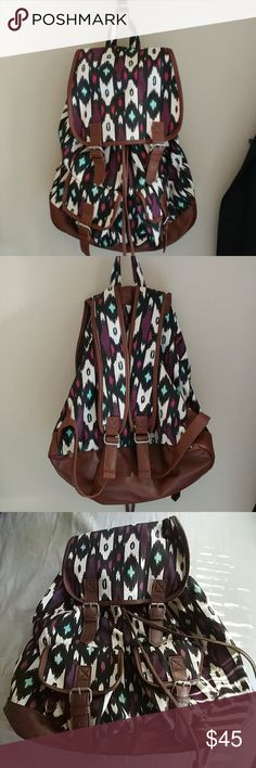 NWOT 💕 Empyre Backpack Amazing backpack. Never used. 2 front pockets with snap closure. Internal pocket (usual small you would find in a purse). Backpack closes by leather string tightening & 2 snap closures. Colors: Purple, Teal, Black & Brown Empyre Bags Backpacks